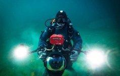 Jett Britnell diving in Pavilion Lake BC Photo by Michel Joseph e1625801221657